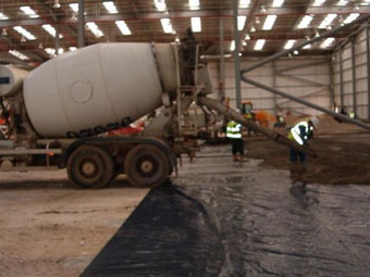 concrete being discharged onto membrane